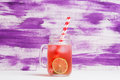 Raspberry lemonade with lice and ice in the glass Royalty Free Stock Photo