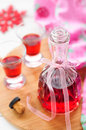 Raspberry liqueur a bottle and two shots of homemade Stock Photo