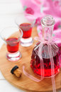Raspberry liqueur a bottle and two shots of homemade copy space for your text Royalty Free Stock Image