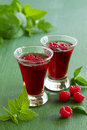 Raspberry liqueur in glasses selective focus Stock Images