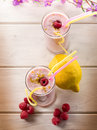 Raspberry  milkshake on glass Royalty Free Stock Photos
