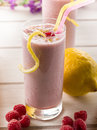Raspberry  milkshake on glass Royalty Free Stock Image