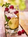Raspberry mojito with cubes ice glass. Outdoor. Royalty Free Stock Photo