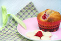Raspberry muffin and white chocolate on pink plate white chocolate melts and in the foreground Stock Photography
