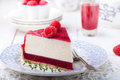 Raspberry and roast bell pepper mousse cake cheesecake chili with fresh on a white wooden background Stock Image
