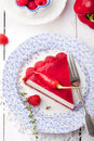Raspberry and roast bell pepper mousse cake cheesecake chili with fresh on a white wooden background Stock Photos