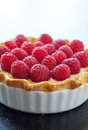 Raspberry tart fresh red with vanilla pastry cream and delicate golden crust Stock Photo