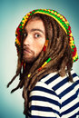 Rasta emotion portrait of a rastafarian young man Royalty Free Stock Image