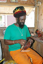 Rasta man leather craftsman Carriacou Royalty Free Stock Images