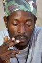 Rastafarian smoking cannabis Royalty Free Stock Images