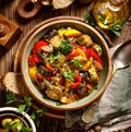 Ratatouille, Vegetarian stew made of zucchini, eggplants, peppers, onions, garlic and tomatoes with addition of aromatic herbs, to