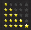 Rating stars yellow filling dents forms on a dark background Royalty Free Stock Photos