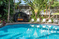Rattan cabana by poolside brown in tropical paradise Royalty Free Stock Photography
