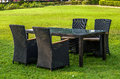 Rattan furniture, table and chairs outdoors Royalty Free Stock Photo