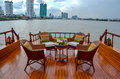 Rattan furniture, table, chairs on river boat Royalty Free Stock Photo