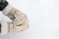 Rattan heart in hands Royalty Free Stock Photo