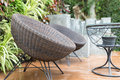 rattan wicker chair and desk on patio Royalty Free Stock Photo