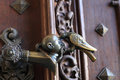 Raven killing a man door handle in the palace czech republic Royalty Free Stock Images