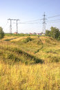 Ravine line of electricity transmissions on verge of Stock Photos