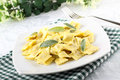 Ravioli with butter and sage on complex background Stock Photo