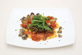 Ravioli with clams tomato sauce and arugula this is a typical italian dish Stock Photography