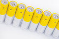 Raw of aa alkaline batteries yellow isolated on white background Royalty Free Stock Image