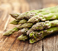 Raw asparagus on wooden board closeup of a bunch of fresh a rustic Royalty Free Stock Photography