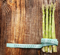 Raw asparagus on wooden board closeup of a bunch of fresh a rustic Royalty Free Stock Photos