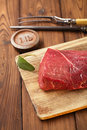 Raw beef meat fillet on wooden table with fork and lb iron weight Stock Images