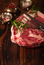 Raw beef Ribeye  steak   on wooden  table Royalty Free Stock Photo