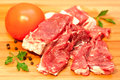 Raw beef with spices and vegetables Stock Photo