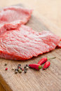 Raw beef steak and chilli pepper Stock Photography
