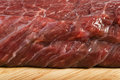 Raw beef steak meat on kitchen board close up Stock Image