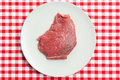 Raw beef steak on plate Stock Photos