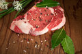 Raw beef steak seasoned ready for cooking Stock Photo