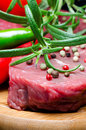 Raw beef steak on wooden board Royalty Free Stock Photo
