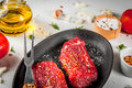 Raw beef steaks with vegetables Royalty Free Stock Photo