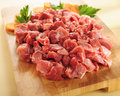 Raw beef stew. Arrangement on a cutting board. Royalty Free Stock Photos