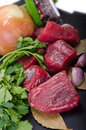 Raw beef and vegetables Stock Photo
