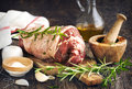 Raw boneless lamb leg with garlic and rosemary Royalty Free Stock Photo