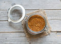 Raw brown millet in a glass jar Royalty Free Stock Photo