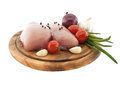 Raw chicken breasts on wooden cutting board with vegetable, isol Royalty Free Stock Photo