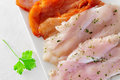 Raw chicken meat some slices of marinated with paprika and parsley and olive oil in a plate Royalty Free Stock Photography
