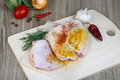 Raw chicken thights with paprika dill and garlik Stock Photography