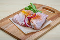 Raw chicken thights two with herbs and spices Stock Photo