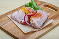 Raw chicken thights two with herbs and spices Royalty Free Stock Photos