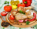 Raw chicken and vegetables on a white table Stock Photos
