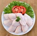 Raw chicken wings with vegetables Royalty Free Stock Photo