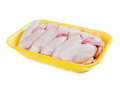 Raw chicken wings in yellow tray Royalty Free Stock Photo
