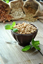 Raw chickpeas in a brown bowl with herbs Royalty Free Stock Images